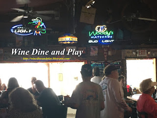The bar and dining room to Woody's Waterside in St. James City, Florida on Pine Island is catered to the sports fan with a good menu that goes beyond bar food.