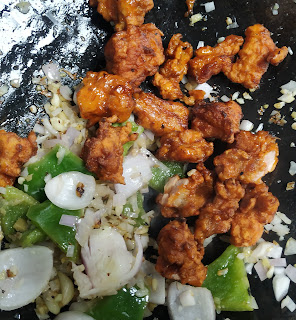 Stir frying chicken with onions capsicum ginger garlic for Chilli chicken recipe