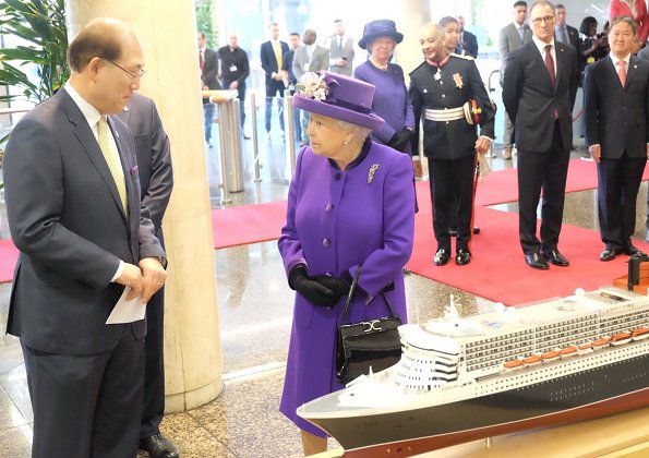 Britain's Queen Elizabeth II visited the International Maritime Organization (IMO) in London