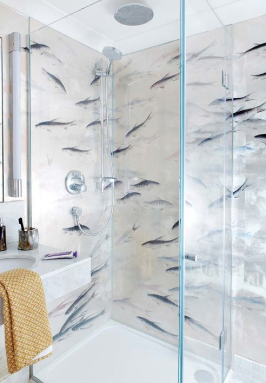 modern shower featuring  fish roam paper Fishes from De Gournay.