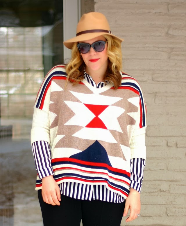 tribal sweater over striped blouse