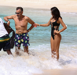 Nigora-Bannatyne-in-an-one-piece-black-swimsuit-at-the-beach-in-Barbados.-m7idk7axtv.jpg