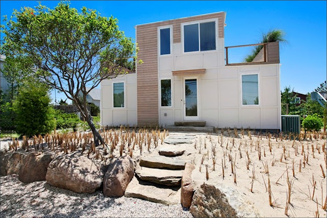 fachada Casa de praia sofisticada containers