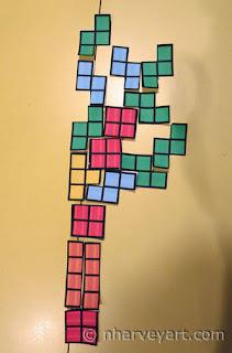 Arranging paper Tetris pieces 2