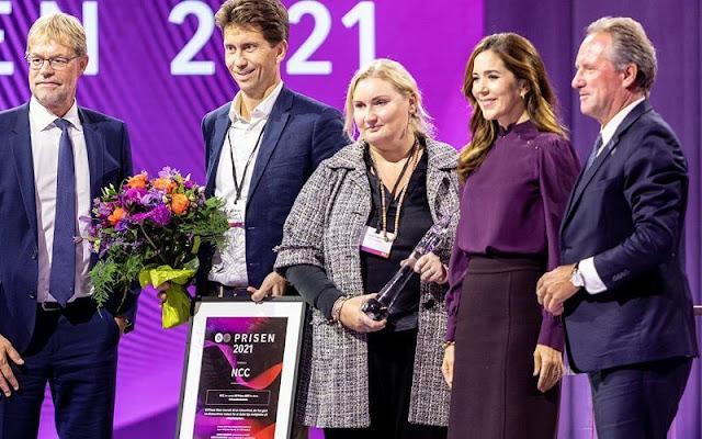Crown Princess Mary wore a burgundy, purple silk top and burgundy purple wool midi skirt