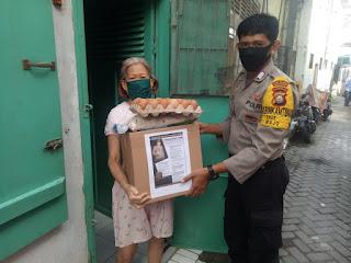 Polsek Wajo Mendistribusikan Bantuan Sembako Kapolres Pelabuhan Makassar