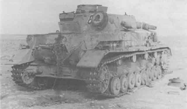 Knocked-out Panzer IV in Libya, November 1941 worldwartwo.filminspector.com