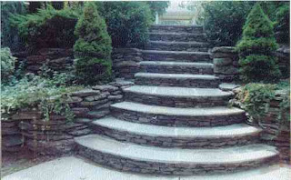 a tiered landscaping going up a stone stairway