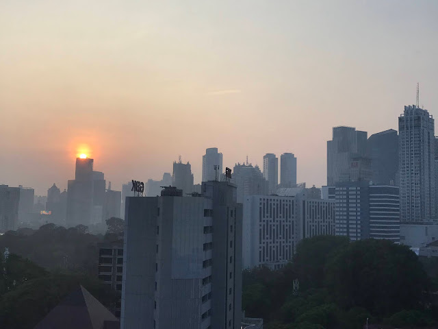 The sunrise over Jakarta's sky