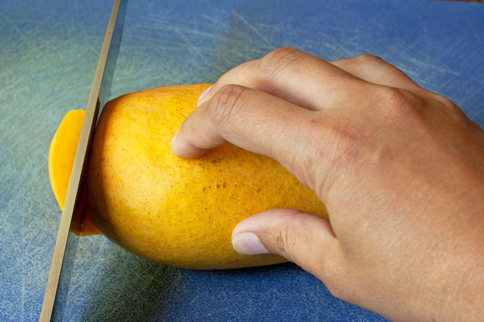 Slice off the lower tip of the mango