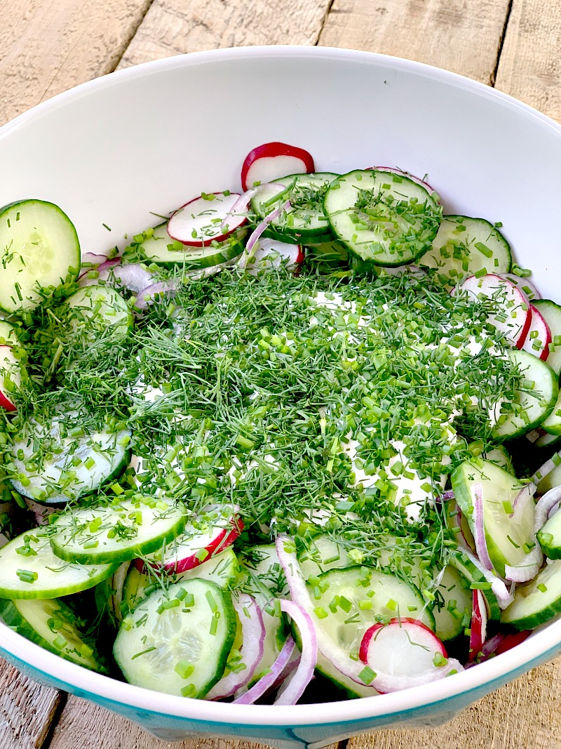 This low carb cucumber salad recipe is made with fresh cucumbers, radishes, red onions, and fresh herbs, for a keto-friendly side dish that the whole family will love. It's light, creamy, and very easy to make. It is the perfect salad for picnics, pot lucks, or summer grilling. #keto #lowcarb #sidedish #salad #cucumber #easy #recipe | bobbiskozykitchen.com