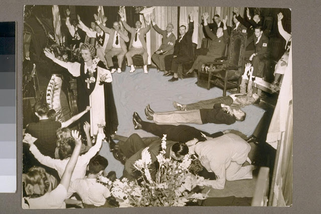 Aimee Semple McPherson (left) leading a service during the annual Four Square Gospel Church Convention at the Angelus Temple in Echo Park (1942)