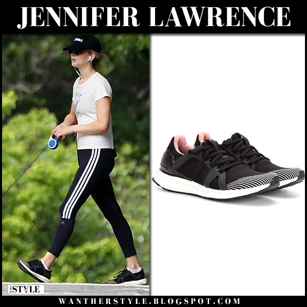 Jennifer Lawrence walking her dog in black leggings and sneakers adidas casual style june 11