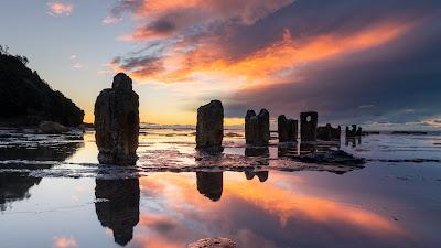 HD wallpaper stone columns on the beach