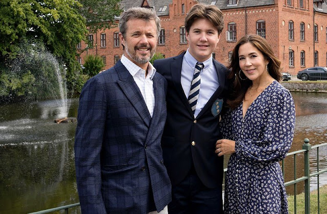 Crown Prince Frederik and Crown Princess Mary. Moss & Spy navy floral broderie anglaise cotton v-shaped front neckline dress. Beulah London dress