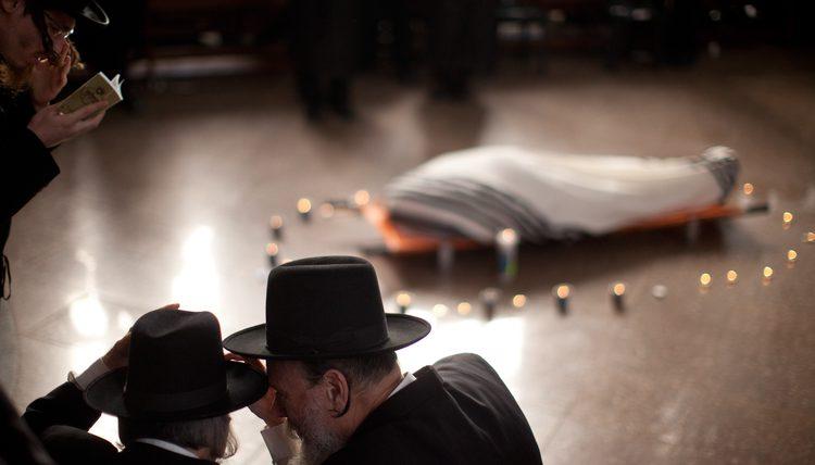 45b3290fd2e Talmudic Jews reciting Kaddish over a dead body.