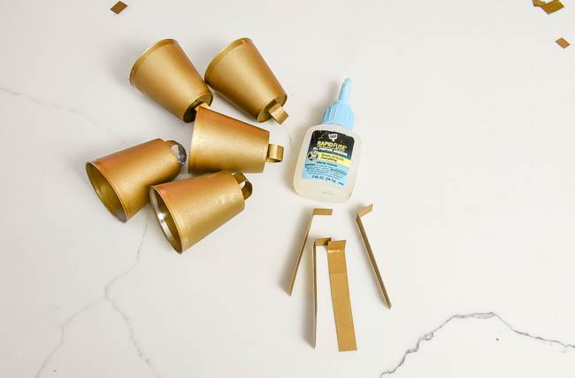 Glueing clappers onto DIY brass bells