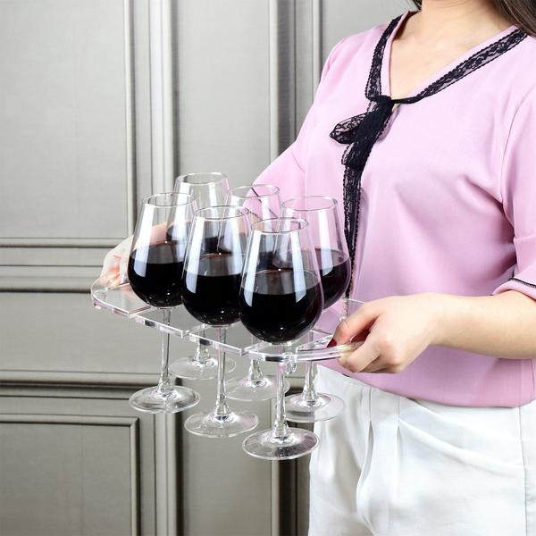 Woman carrying the Clear Acrylic Wine Glasses Tray from Nile Corp, holding 6 glasses of wine