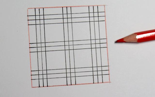 Contorno del cuadrado repasado con lápiz rojo