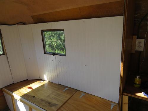 paneling inside a fiberglass trailer