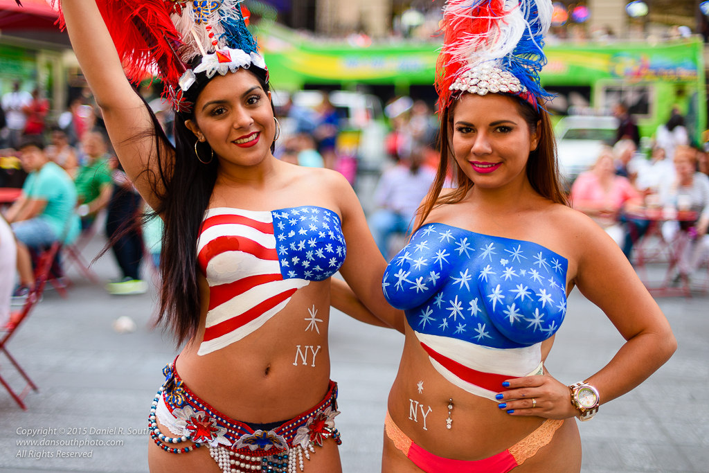 a photo of women in body paint in times square new york