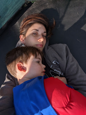 Mum and son chilling on trampoline