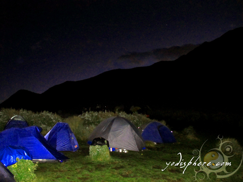 Row of tents: Nightime at the campsite at the summit of Mt. Pulag