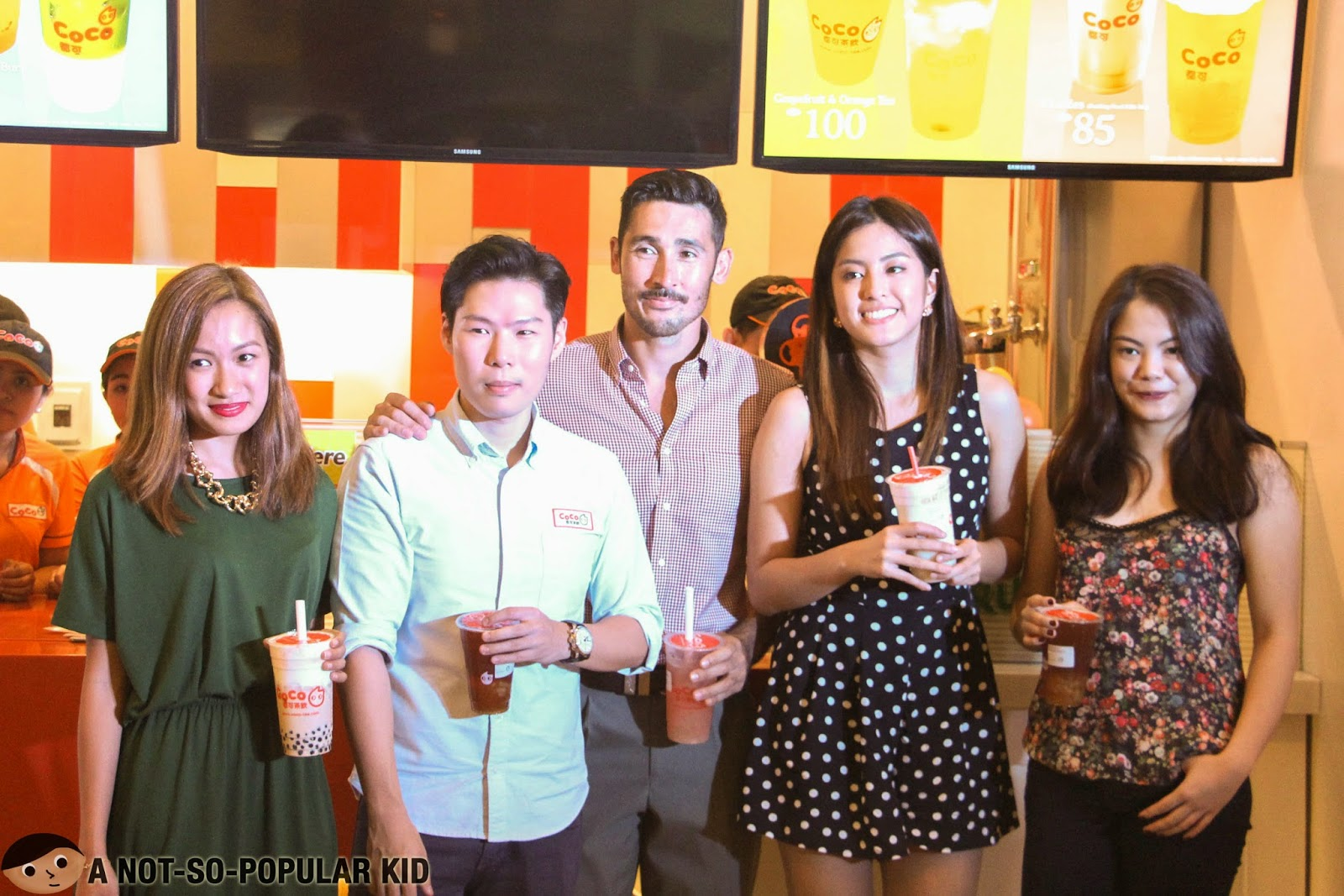 Laureen Uy, Chris Everingham, Gretchen Ho and Selina Dagdag with the store owner of CoCo