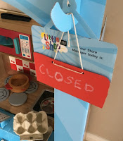 red-closed-sign-hanging-on-M&S-cardboard-my-little-shop