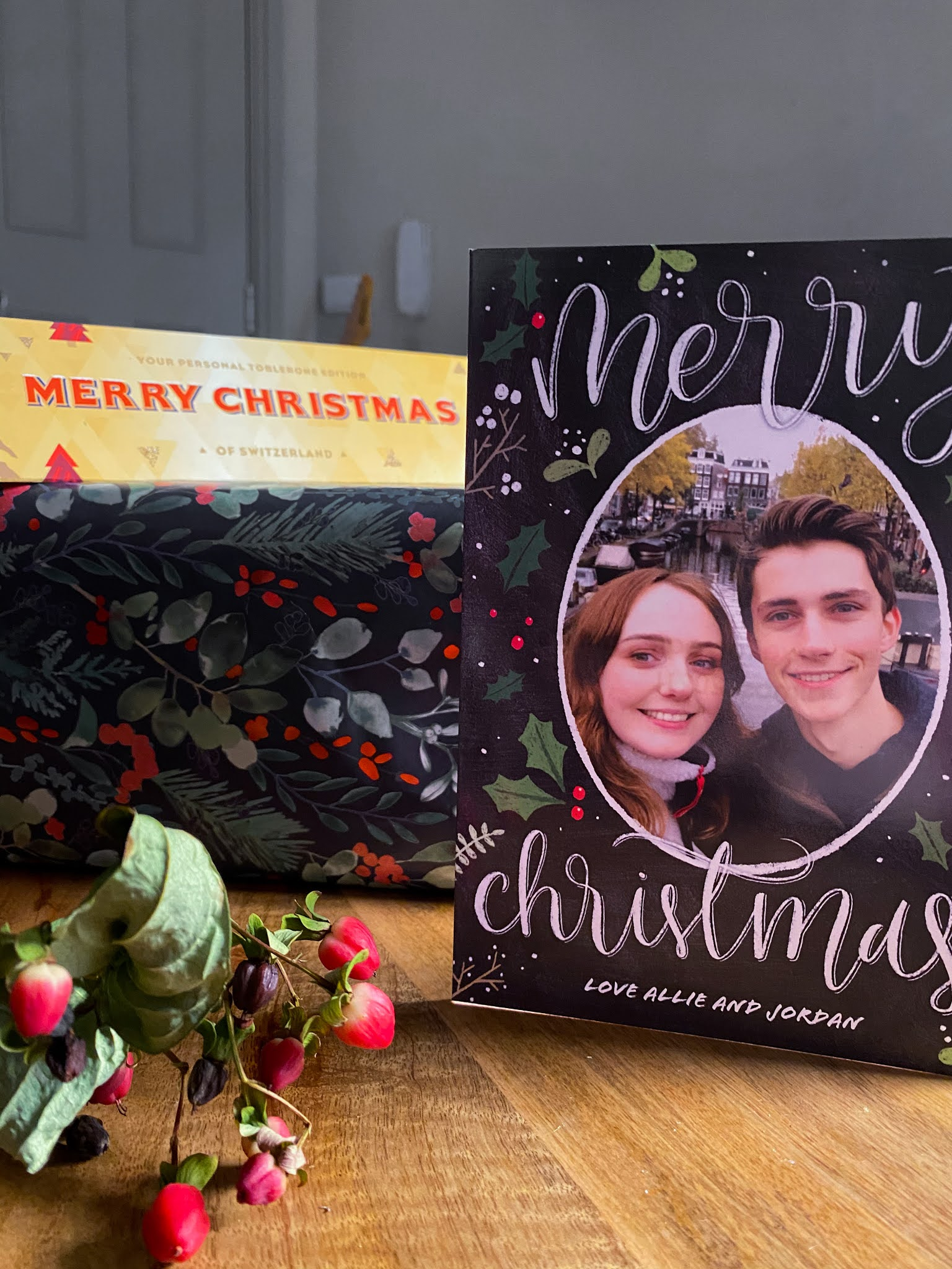 "bar of Toblerone reading ""merry Christmas"" alongside personalised couple's Christmas card"