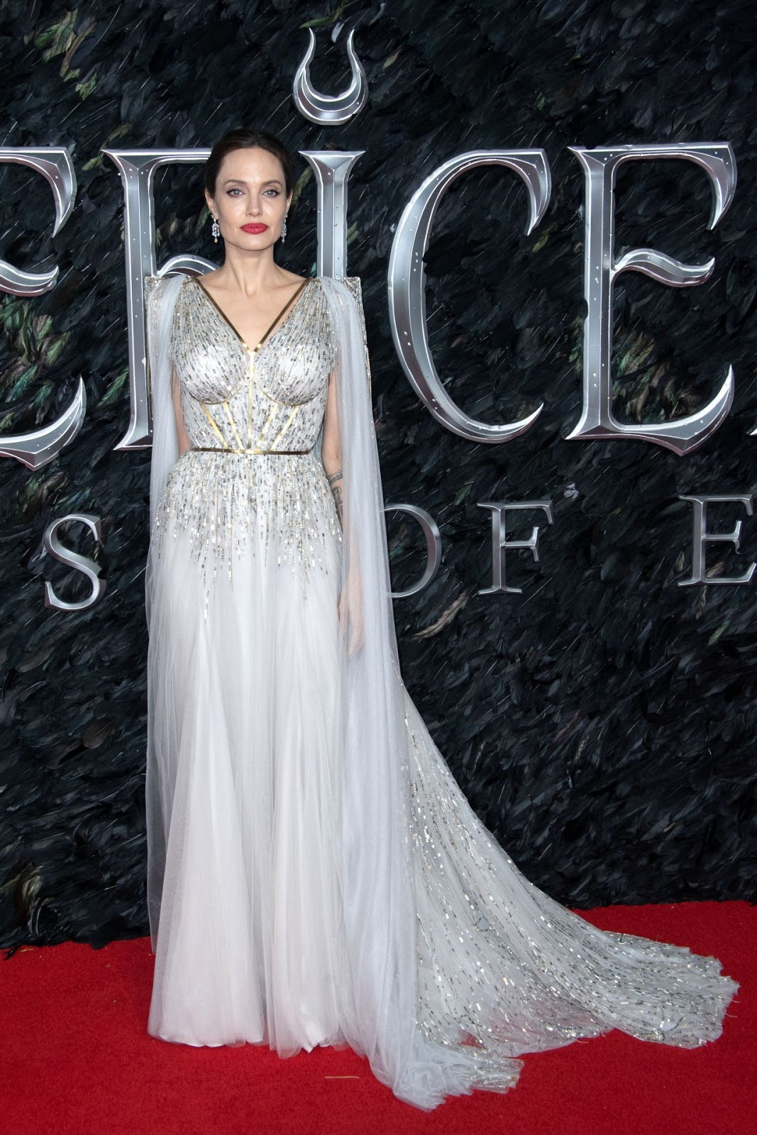 Angelina Jolie wows in a structured silver gown as she attends star-studded Maleficent: Mistress Of Evil premiere in London