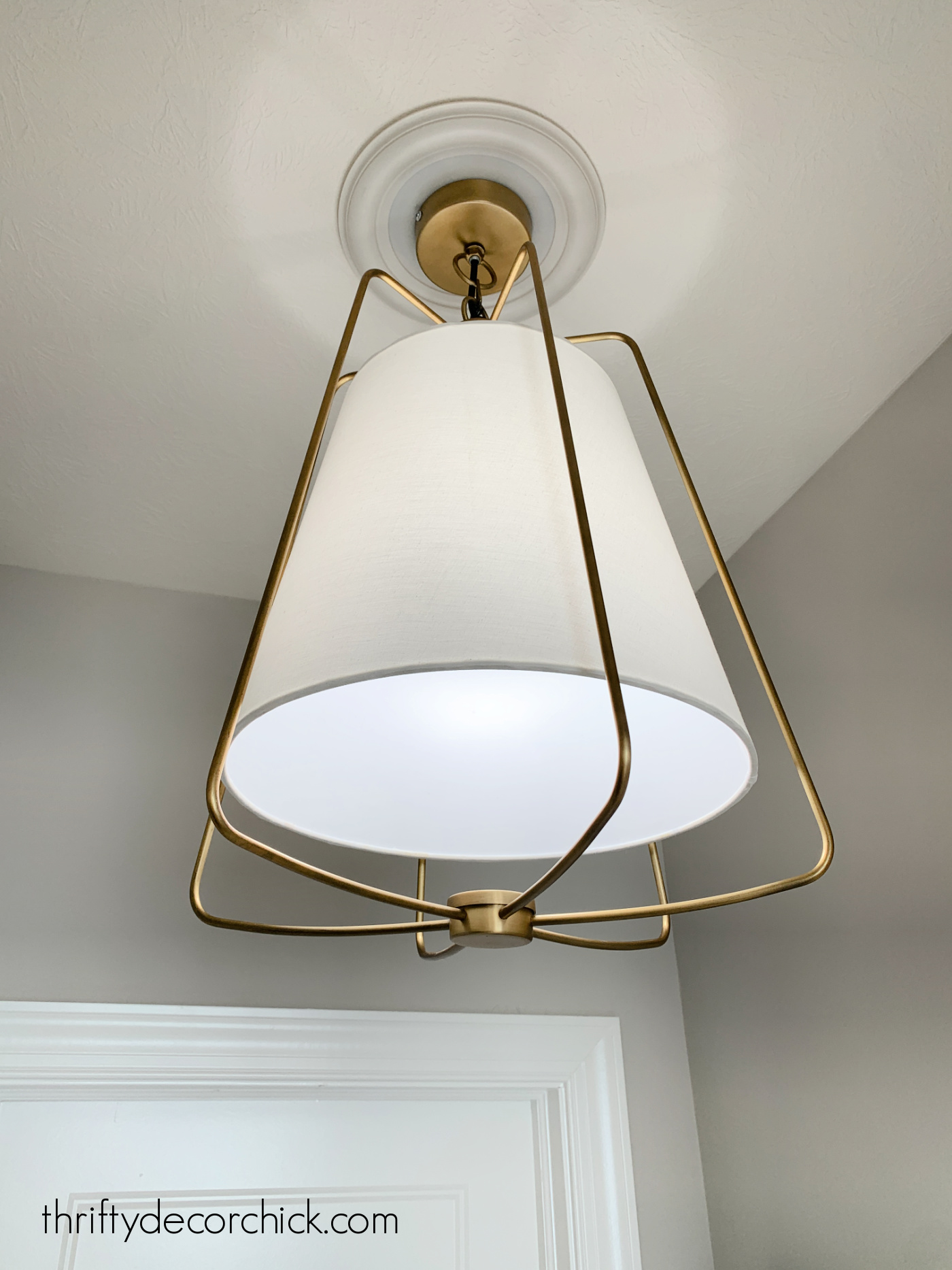 brass and white lamp shade light fixture