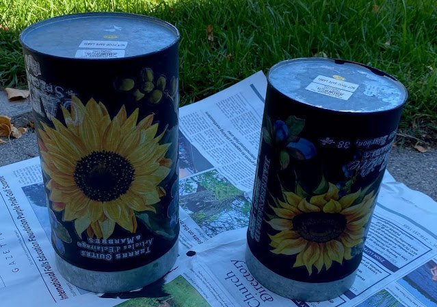 Photo of canisters on newspaper for spray sealing.