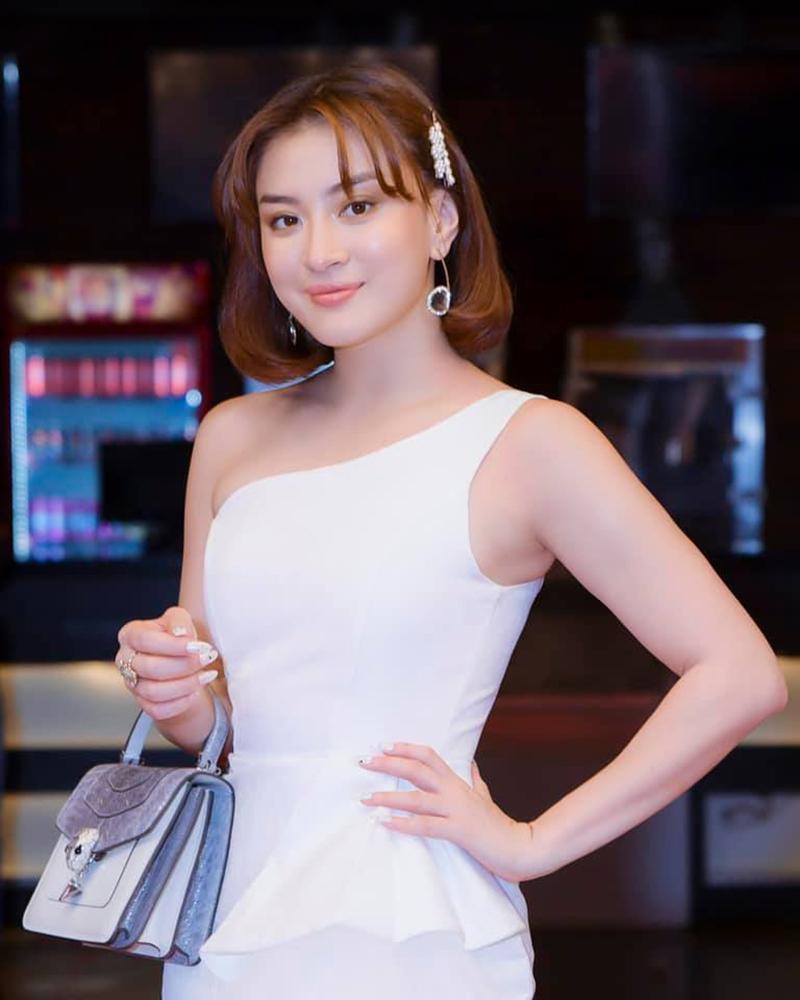 Wutt Hmone Shwe Yi in white One Shoulder dress
