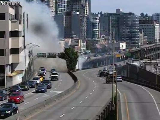 1 arrested after fire underneath Seattle viaduct
