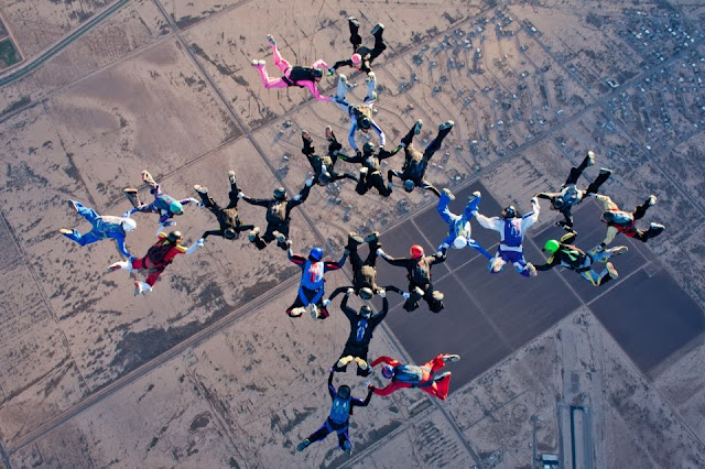 Bekie flying with her skydiving team