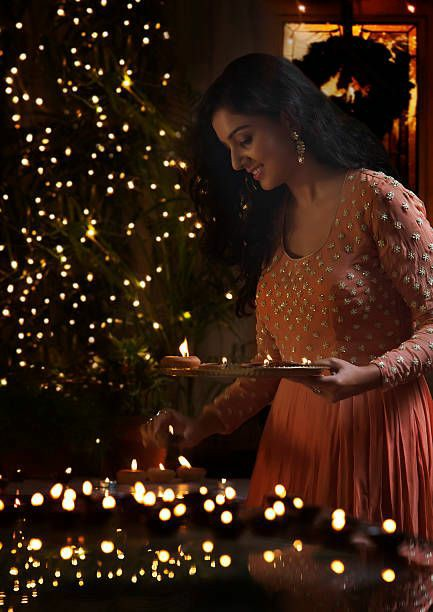 diwali pose on home with diya for girls