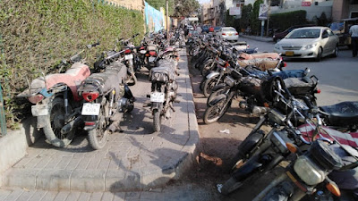 Illegal parking in public park removed on Khabar Kahani news - Photo by Khabar Kahani