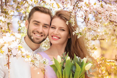Tulips-flowers-in-background-Brown-haired-beautiful-couple