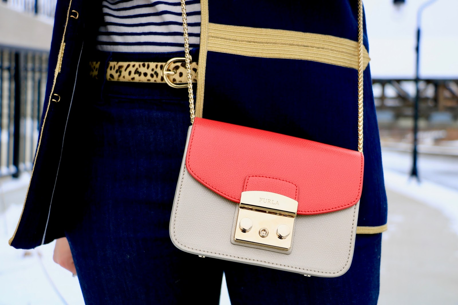 Nyc fashion blogger Kathleen Harper wearing a red Furla mini purse