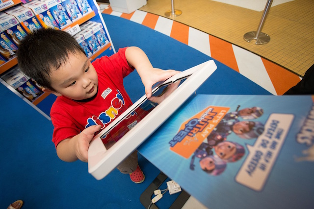 Kid tries out the newly-launched NutriQuest game app