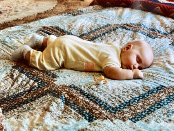 Baby on a quilt | DevotedQuilter.com