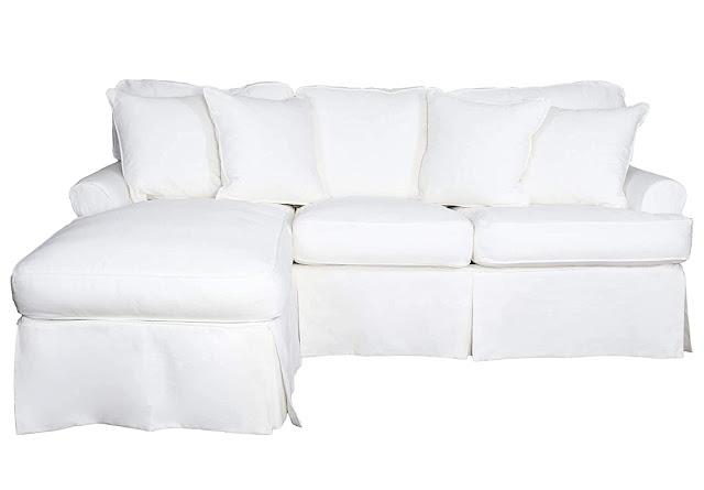 white slipcovered chaise and sleeper sofa combo