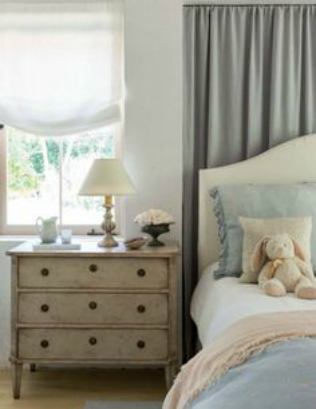 Patina Farm gorgeous bedroom with pastels, Swedish antiques, and bunny on bed