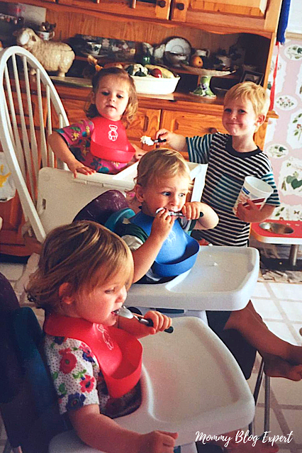 Toddler Triplets Eating in Booster Seats High Chair