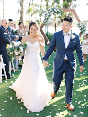bride and groom with rose petal toss