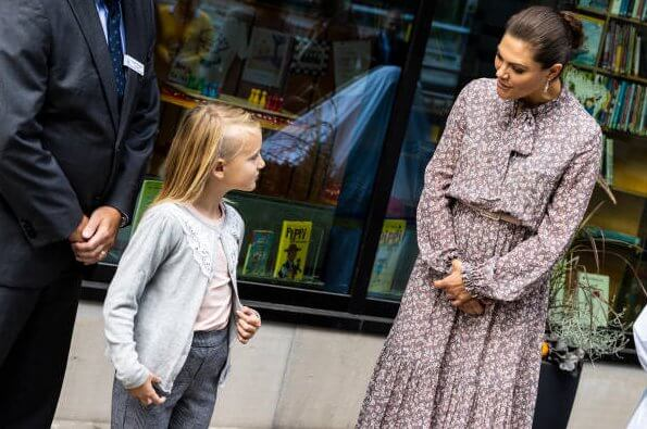 Crown Princess Victoria wore a Pattriina floral print long dress from Andiata and Victoria wore an Odnala  wool cashmere jacket from Andiata