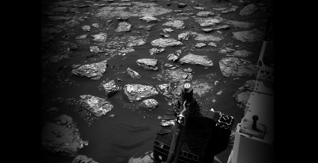 "This Dec. 2, 2016, view from the Navigation Camera (Navcam) on the mast of NASA's Curiosity Mars Rover shows rocky ground within view while the rover was working at an intended drilling site called ""Precipice"" on lower Mount Sharp. Credit: NASA/JPL-Caltech"