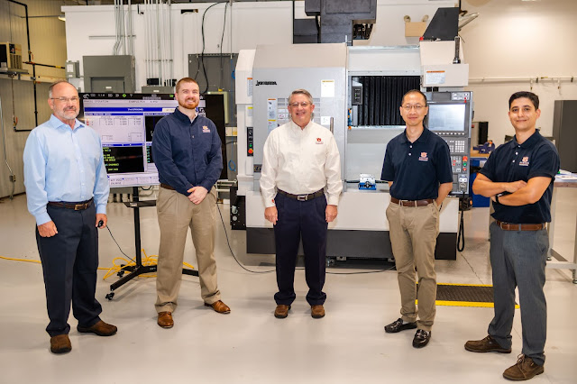 Image Attribute: The Interdisciplinary Center for Advanced Manufacturing at Auburn University, housed within the Department of Industrial and Systems Engineering, is led by Lewis Payton, associate research professor (left); Greg Purdy, assistant professor (second from left); Greg Harris, ICAMS director and associate professor (center); Peter Liu, assistant professor (second from right); and Konstantinos Mykoniatis, assistant professor (right).
