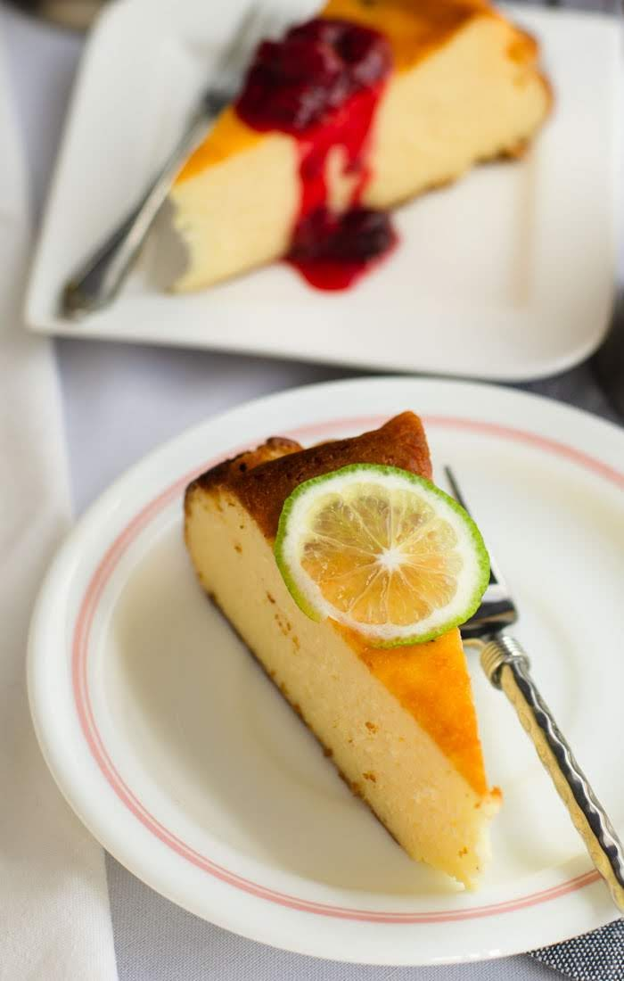 A slice of Basque burnt cheesecake with a slice of lime